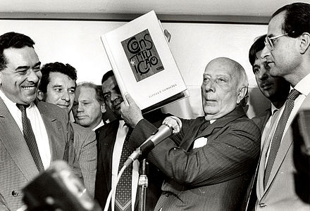 Ulysses Guimaraes holding the Constitution of 1988 in his hands. Ulyssesguimaraesconstituicao.jpg