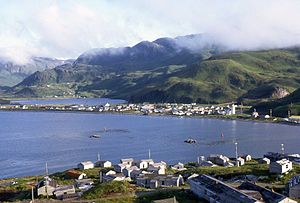 Unalaska, Alaska - Unalaska view in 1972 with the collapsed buildings of the closed naval base in the foreground.