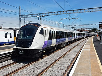 Crossrail - A Class 345 train in Elizabeth Line livery, with temporary TfL Rail branding