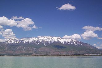 Wasatch Front - Mount Timpanogos, in the Wasatch Range, viewed from Utah Lake. Several Wasatch Front cities lie between these natural features.
