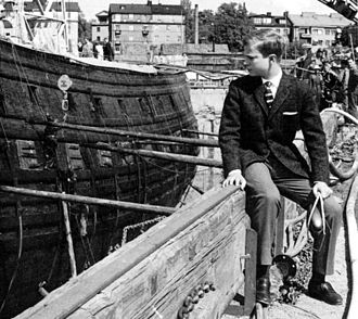Carl XVI Gustaf of Sweden - The 15-year-old Crown Prince of Sweden looks at the recently recovered 17th century warship Vasa in 1961.