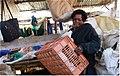 Vegetable vendor in slum.jpg