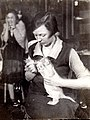 Vera Chaplina feeds the lioness Kinuli.jpg