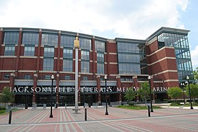 "A low but large 5-story brick and glass building, with the letters ""Jacksonville Veterans Memorial Arena"" mounted above the entrance."