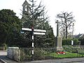 War Memorial and finger post, Manston - geograph.org.uk - 382751.jpg