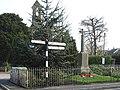 War Memorial and finger post, Manston - geograph.org.uk - 382751.jpg