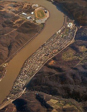 Wellsville from the air looking north.Wellsville is on left side of river. On upper right side of river is the Quaker State Oil Refinery in Newell WV.  On the lower right side of river is the Mountaineer Casino and Race Track in New Cumberland, WV