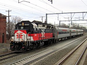 EMD GP40-based passenger locomotives - SLE GP40-2H 6699 leading a westbound train, approaching Guilford Station.