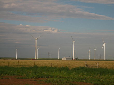 Landowners in the US typically receive $3,000 to $5,000 per year in rental income from each wind turbine, while farmers continue to grow crops or graze cattle up to the foot of the turbines. Windmills south of Dumas, TX IMG 0570.JPG