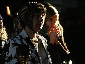 Two women praying in Ukraine, probably Orthodox.