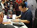 WonderCon 2011 - Marvel's Chief Creative Officer and former Editor-in-Chief, Joe Quesada signs for fans (5581411112).jpg