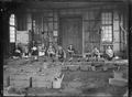 Workers and mouldings in the foundry at the Petone railway workshops ATLIB 141132.png