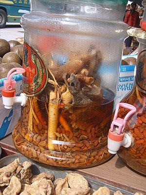 Tokay gecko - Ready to drink macerated medicinal liquor with goji berry, tokay gecko, and ginseng, for sale at a traditional medicine market in Xi'an, China.