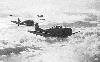 Invasion of Tulagi (May 1942) - Yorktown SBD-3 dive bombers return to their carrier after striking Japanese shipping in Tulagi harbor.
