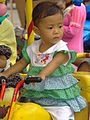 Young Girl on Fair Ride - Outside Retribution Museum - Jakarta - Indonesia.jpg