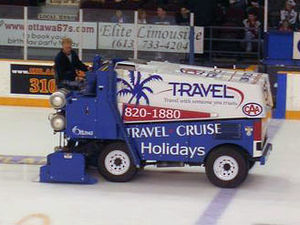 Paramount, California - A Zamboni ice resurfacer lays down a layer of clean water, which will freeze to form a smooth ice surface.