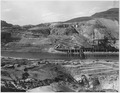 """""""Three-view panorama from top of east abutment . The Eastmix concrete plant under construction appears in the center... - NARA - 294277.tif"""