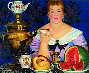 Kalach (food) - Boris Kustodiev. A merchants's wife drinking tea, 1923. A kalach in the form of a kettlebell is depicted as was common in central and northern parts of Russia.