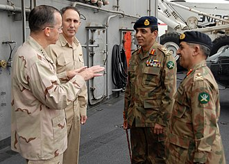 Structure of the Pakistan Army - From left, Chairman of the Joint Chiefs of Staff Navy Adm. Mike Mullen and Rear Adm. Scott Van Buskirk, commander of Carrier Strike Group 9, speak with Chief of Army Staff of the Pakistan Army Gen. Ashfaq Kayani and Pakistani Maj. Gen. Ahmad Shuja Pasha, director general of military operations, on the flight deck of the aircraft carrier USS Abraham Lincoln (CVN 72) while under way in the North Arabian Sea Aug. 27, 2008.