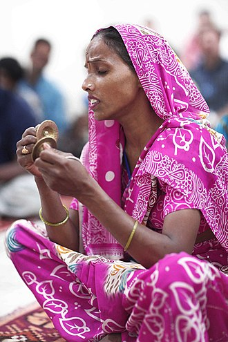 Tala (music) - Tala refers to musical meter in classical Indian music. Above: a musician using small cymbals to set the tala.