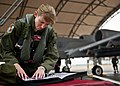 130110-f-oc707-002 Female Fighter Pilot Maj. Olivia Elliott examines the logbook for her A-10 Thunderbolt II.jpg