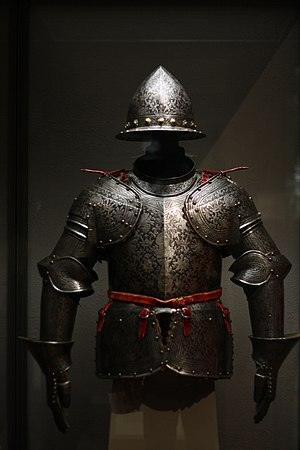 Chemical milling - An etched and partially russeted and gilded half armor made of steel, brass, leather, and textiles