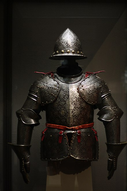 An etched and partially russeted and gilded half armor made of steel, brass, leather, and textiles 1600 Milan Half Armor.jpg