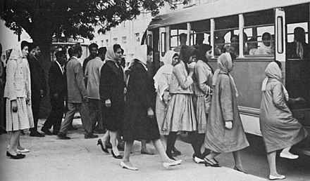 Men and women entering a public transport bus in the 1950s 1950s Afghanistan - Public transport in Kabul.jpg