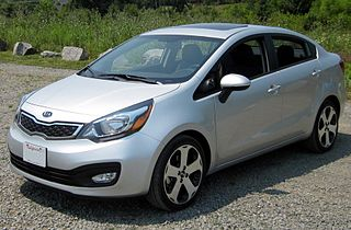 http://upload.wikimedia.org/wikipedia/commons/thumb/6/65/2012_Kia_Rio_SX_sedan_--_06-28-2012_front.JPG/320px-2012_Kia_Rio_SX_sedan_--_06-28-2012_front.JPG