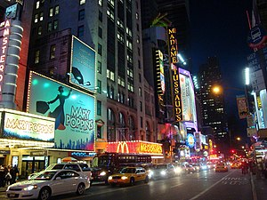 Night on 42nd Street in Manhattan showing sign...