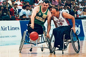 Australia men's national wheelchair basketball team - Australian wheelchair basketballer Orfeo Cecconato takes on a Great Britain defender in the final of the men's wheelchair basketball tournament at the 1996 Atlanta Paralympic Games
