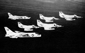 A-4Cs VA-146 with F-8Cs VF-194 in flight 1964.jpg