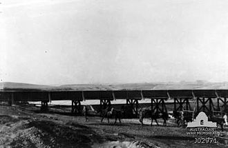 Southern Palestine Offensive - A military railway bridge over the Wadi Ghazzeh, with water storage beyond. EEF horses watered in this vicinity during September and October 1917