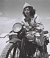 A Hagana dispatch rider, Drora Harehuveni, on her motocycle.jpg