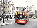 A London Buses route 23 bus enters Cannon Street from Queen Victoria Street, City of London, 30 May 2011.jpg