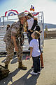 A U.S. Marine with the 1st Battalion, 5th Marine Regiment, assigned to Marine Rotational Force-Darwin, kisses a child during a homecoming event at Marine Corps Base Camp Pendleton, Calif., Oct. 20, 2014 141020-M-SE196-005.jpg