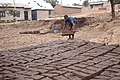 A man making mud blocks.jpg