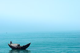 A men doing his daily duty in middle of Bay of Bengal sea.jpg