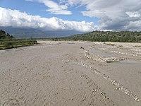 A muddy flooded braided stream west of Laga village.jpg