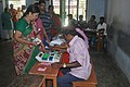 A polling officer administering indelible ink to a voter at a polling booth at Mylapore constituency during Tamil Nadu Assembly Election, in Chennai on April 13, 2011.jpg