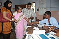 A polling officer administering indelible ink to a voter at a polling station in the Kerala Assembly Election, at Thiruvananthapuram on April 13, 2011.jpg