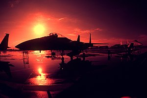 A silhouette view of a parked F-15 Eagle aircraft DF-ST-82-05588.jpg