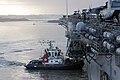 A tugboat helps USS Kearsarge enter port. (8597781188).jpg