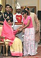 A visually handicapped girl tying Rakhi on the President Smt. Pratibha Patil on Raksha Bandhan at Rashtrapati Bhavan, in New Delhi on August 28, 2007.jpg