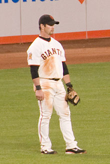Aaron Rowand, playing with the San Francisco Giants, stands in the outfield.