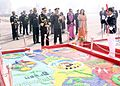 Admiral DK Joshi witnessing the colourful display of tableaus at NCC Republic Day Camp 2014.jpg