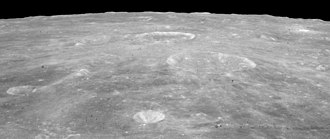 Agrippa (crater) - Oblique view facing south from Apollo 15, with Agrippa right of center, and the crater Godin above center showing bright rays.