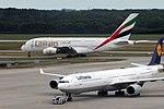 Airbus A380-861 Emirates A6-EDX and Airbus A340-642 Lufthansa D-AIHH (9555284069).jpg