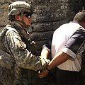 American Airborne Soldier arresting an Iraqi suspect.jpg