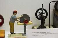 Antique toy factory worker (25247715816).jpg